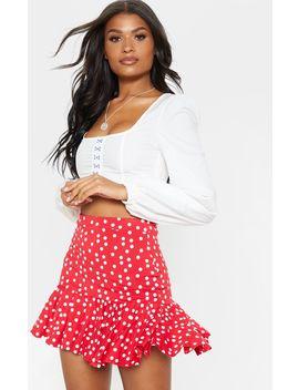 Red Polka Dot Frill Hem Mini Skirt  by Prettylittlething