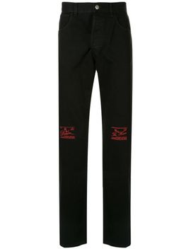 The House Embroidered Jeans by Raf Simons