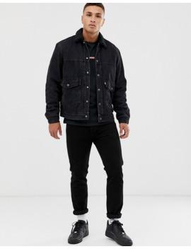 Levi's – Ricky – Gefütterte Truckerjacke Aus Jeansstoff Mit Aufgesetzter Tasche In Verwaschenem Schwarz by Asos