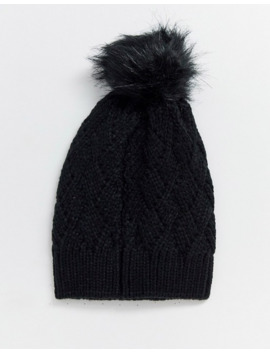 River Island Knitted Beanie Hat With Faux Fur Pom Pom In Black by River Island