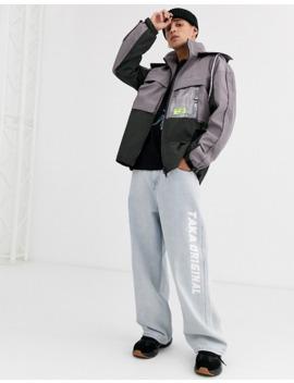 Taka Original Utility Windbreaker Jacket With Pvc Pocket And Draw Cords by Taka Original