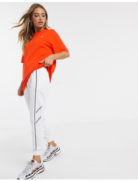 Nike Orange Mini Swoosh Oversized T Shirt by Nike