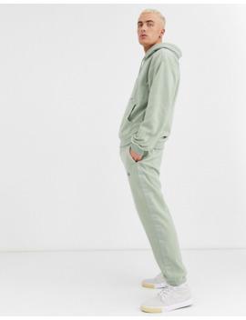 Nike Sb – Nomad – Fleece Jogginghose Mit Seitenstreifen Und Gürtel Mit Clipverschluss In Khaki by Asos
