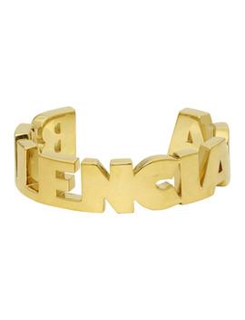 Gold Typo Bracelet by Balenciaga
