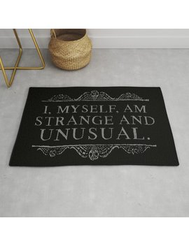 """I, Myself, Am Strange And Unusual.""  Lydia Deetz Rug by Society6"
