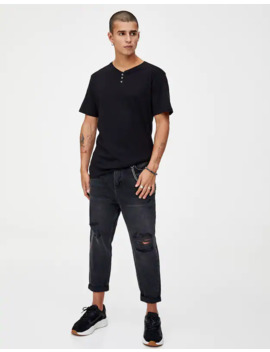 Jeans Relax Fit Con Strappi by Pull & Bear