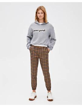 Kohandatud Ruudulised Venivate Sääreotstega Püksid by Pull & Bear