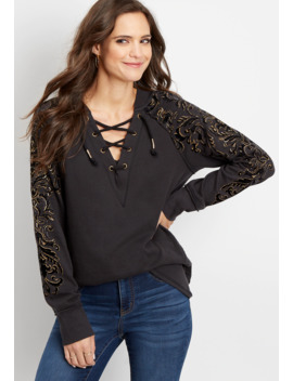 Lace Up Studded Graphic Pullover by Maurices