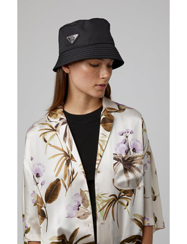 Logo Embellished Shell Bucket Hat by Prada