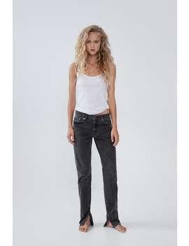 Dopasowane Spodnie Jeansowe Z Wysokim Stanem I RozciĘciami Przy Mankietach Nogawek by Zara