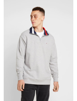 Solid Zip Mock Neck   Sweater by Tommy Jeans