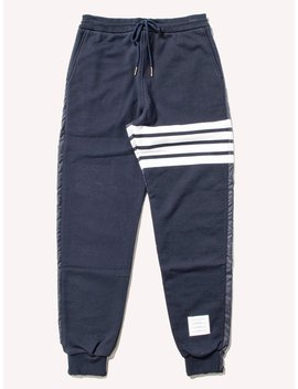 Half And Half Sweatpants In Ripstop & Classic Loopback Jersey With 4 Bar Stripe by Thom Browne