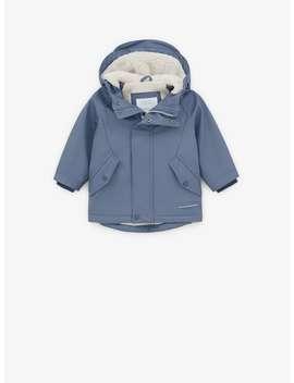 Rubberized Faux Shearling Raincoat by Zara
