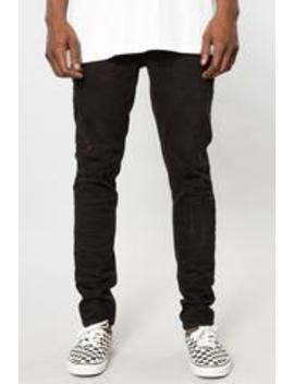 Black Destructed Denim Stacked Skinny Tapered Pant by Elwood Clothing