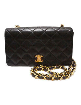 chanel-quilted-mini-matelasse-chain-shoulder-bag-black-leather-lambskin by chanel