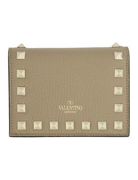 tan-valentino-garavani-small-rockstud-wallet by valentino