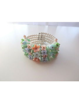 vtg-early-miriam-haskel-glass-pastel-articulated-flowers-wire-cuff-bracelet by ebay-seller