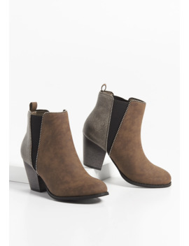 Rebel Embossed Back Ankle Bootie by Maurices