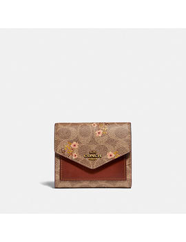 Small Wallet In Signature Canvas With Floral Bow Print by Coach