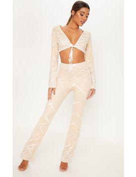 nude-embroidered-sequin-flared-trousers by prettylittlething