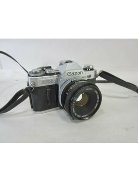 vintage-canon-ae-1-35mm-camera-w_50mm-lens by canon