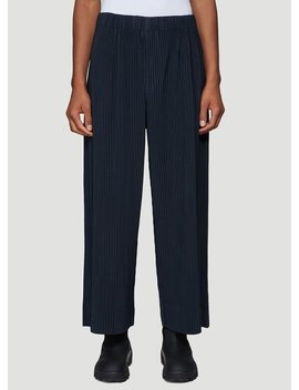 Pleated Wide Leg Pants In Navy by Homme Plissé Issey Miyake