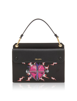 printed-textured-leather-clutch by prada