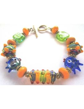 stunning-italy-murano-art-glass-charm-fish-bracelet by ebay-seller