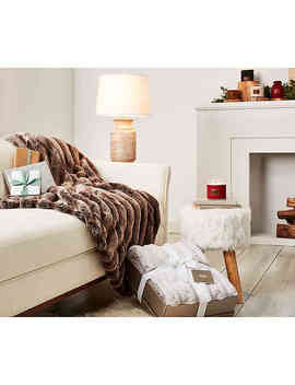 ugg®-wild-luxury-faux-fur-throw-blanket-in-cashew by bed-bath-and-beyond