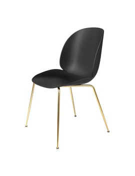 gubi-beetle-dining-chair-un-upholstered-brass-conic-base by houseology