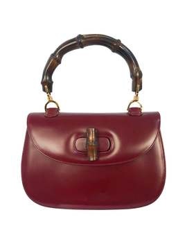 1970s-gucci-wine-leather-handbag-with-bamboo-handle by 1stdibs
