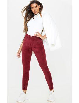 Burgundy Velvet Skinny Jeans  by Prettylittlething