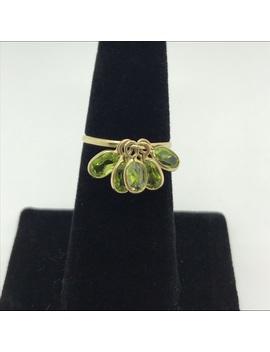 10k Yellow Gold Ring With Dangling Peridot Gems by Poshmark