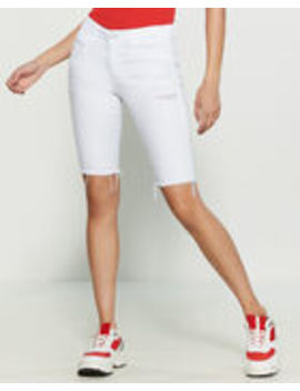 White Cut Off Bermuda Shorts by Vervet