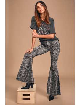 Just Float On Taupe Snake Print High Rise Flare Jeans by Free People