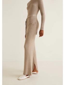 Spodnie Z Prążkowanej Dzianiny Z Rozszerzaną Nogawką by Mango