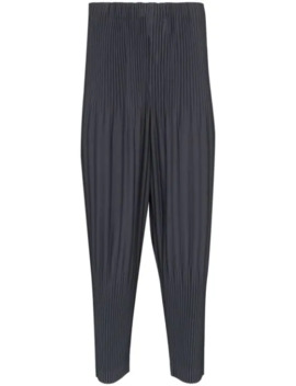 Pleated Tapered Leg Trousers by Homme Plissé Issey Miyake