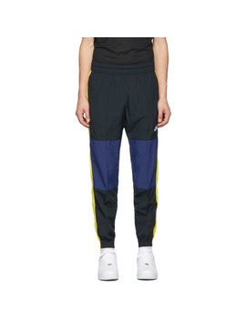 Black & Yellow Re Issue Woven Track Pants by Nike