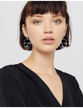 Silver Face Earrings by Accessorize