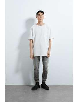 Dopasowane Spodnie Jeansowe Z WystrzĘpieniami by Zara