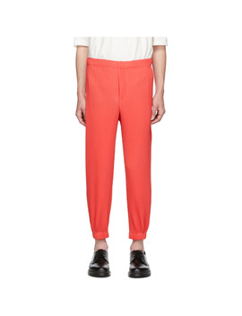 Red Tapered Pleat Trousers by Homme PlissÉ Issey Miyake