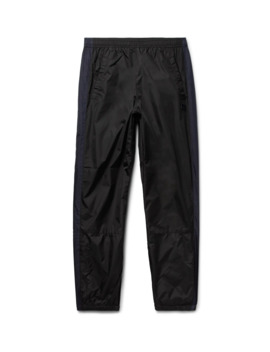 Tapered Logo Appliquéd Striped Nylon Track Pants by Acne Studios
