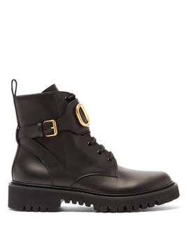 V Logo Tread Sole Leather Ankle Boots by Valentino