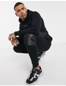 Religion Sweatpants With Utility Contrast Pockets In Black by Religion
