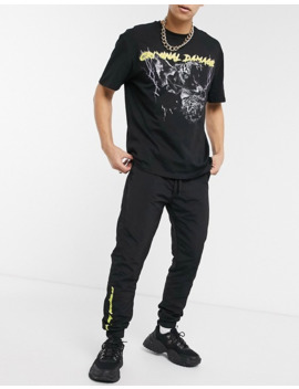 Criminal Damage Nylon Joggers In Black With Neon Logo by Asos