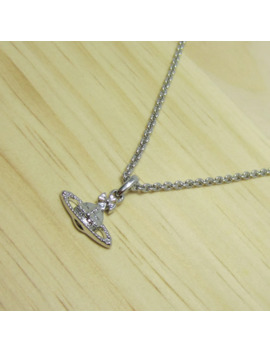 Silver Planet Saturn Necklace Silver Chain by Vintage  ×  Silver  ×  Jewelry  ×