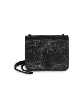 Niki Embossed Leather Crossbody Bag by Saint Laurent
