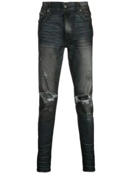 Ausgeblichene Distressed Jeans by Amiri