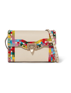 The Rockstud Embroidered Textured Leather Shoulder Bag by Valentino