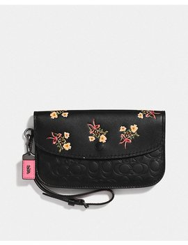 Clutch In Signature Leather With Floral Bow Print by Coach